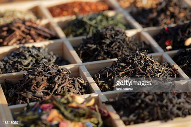 teas in a box - tea leaves stock photos and pictures