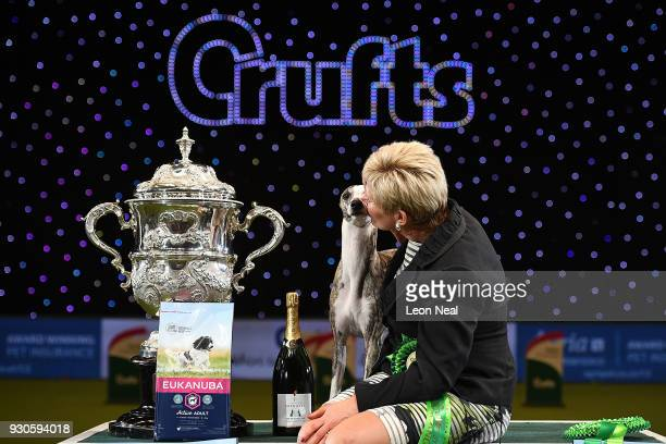 Tease the Whippet is kissed by owner Yvette Short after it wins Best In Show on day four of the Cruft's dog show at the NEC Arena on March 11 2018 in...
