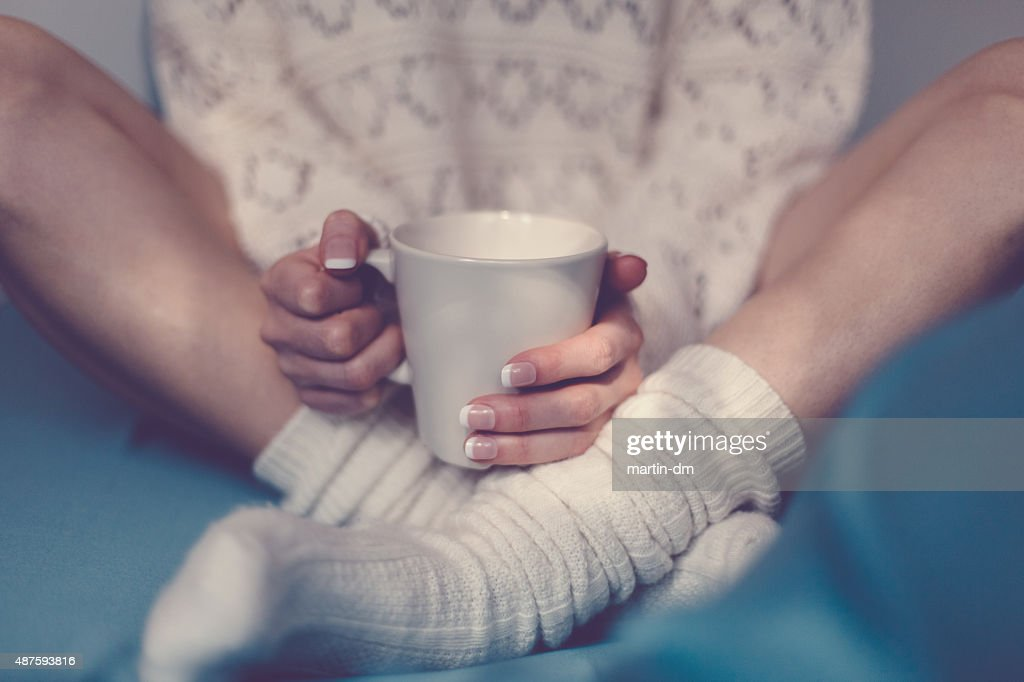 Teatime in bed : Stock Photo