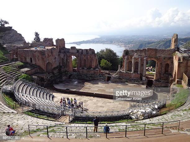 teatro greco and giardini naxos, italy, sicily - giardini naxos stock pictures, royalty-free photos & images