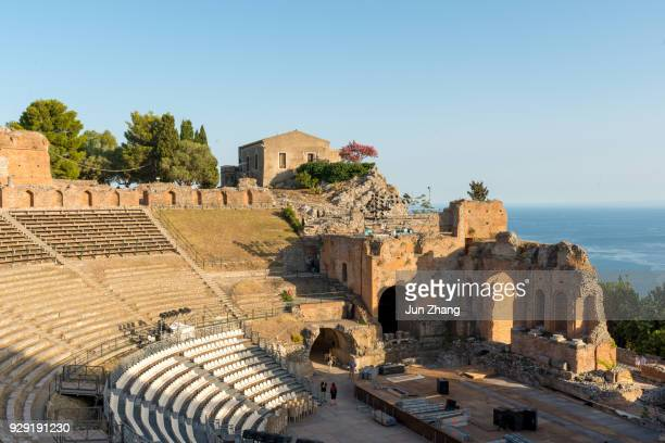 teatro greco (greek theater) in taormina - taormina stock pictures, royalty-free photos & images