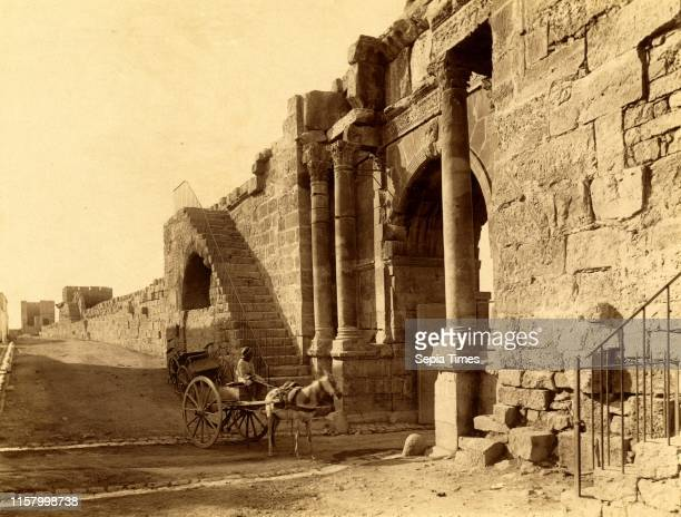 Tebessa Arch of Caracalla and the walls of the Byzantine citadel Algiers Neurdein brothers 1860 1890 the Neurdein photographs of Algeria including...