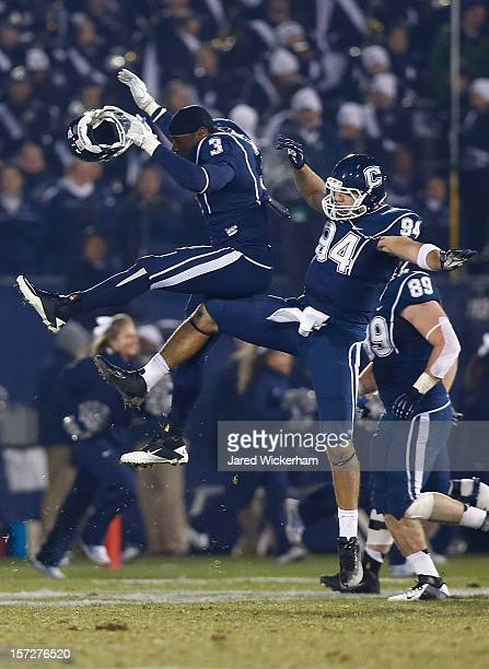 Tebucky Jones of the Connecticut Huskies celebrates with teammate Sio Moore of the Connecticut Huskies after scoring a touchdown against the...