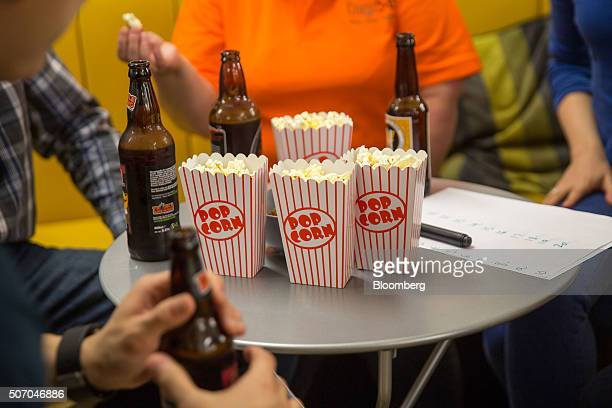Tech entrepreneurs eat popcorn during a networking event on the opening day of the Rise London accelerator setup by Barclays Plc in 2003 and run in...