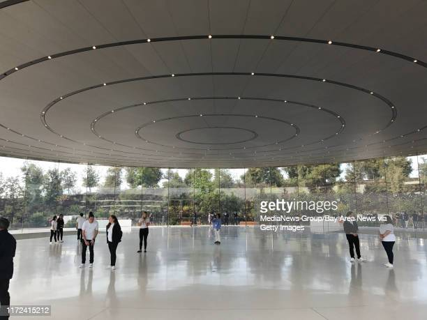 Tech journalists gather at the Steve Jobs Theater before the first-ever product launch at the new Apple Campus in Cupertino on Tuesday.