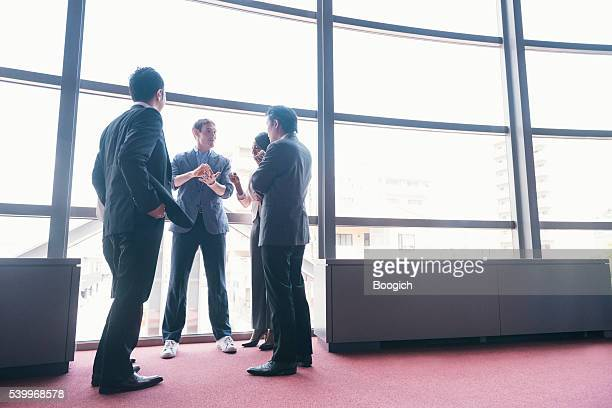 tech startup entrepreneur has business meeting with executive team japan - baseball pitcher stock pictures, royalty-free photos & images