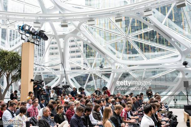 Tech writers and bloggers tune into Amazon's device announcement at The Spheres in Seattle on September 20 2018 Amazon weaves its Alexa digital...