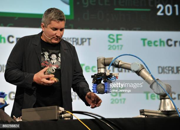 TechCrunch moderator John Biggs onstage interacts with a robot during a Soft Robotics demo at TechCrunch Disrupt SF 2017 at Pier 48 on September 20...