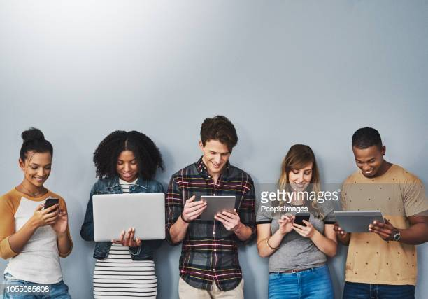 teched out youth of today - generation z stock pictures, royalty-free photos & images