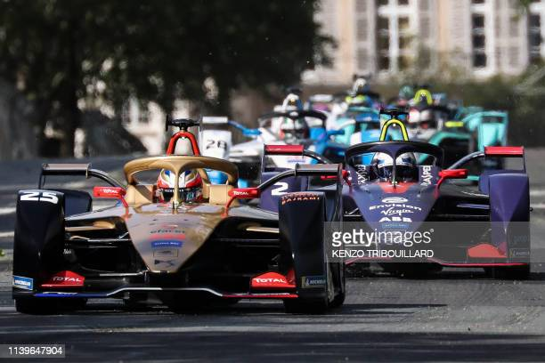Techeetah's french driver JeanEric Vergne steers his car during the Formula E electric car ePrix de Paris around The Invalides Monument in Paris on...
