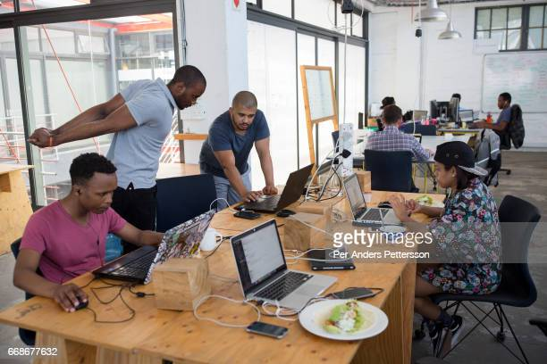 Techies work in a shared office space called Woodstock Exchange where entrepreneurs and small businesses rent office space on November 22 2016 in...