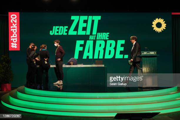 Technical crews make last minute preparations before the opening of the German Greens Party three-day federal party congress during the second wave...