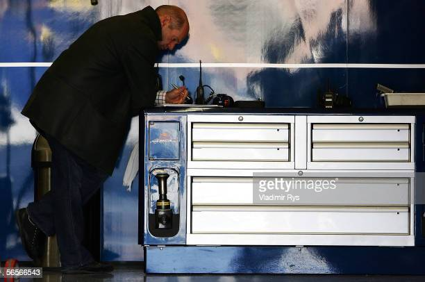 Technical director Adrian Newey of Red Bull Racing writes notes in the garage during testing at Circuito de Jerez on January 11 2006 in Jerez Spain