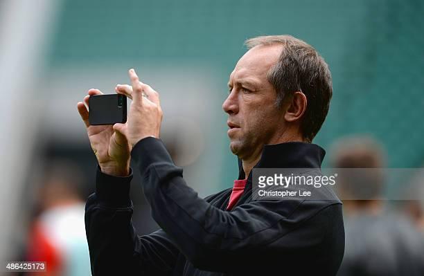 Technical Director Brendan Venter seems to be taking photographs of the stadium during Saracens Captain's Run at Twickenham Stadium on April 24 2014...