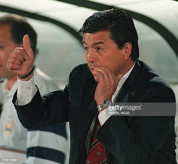 Technical director of the Uruguayan soccer team Argentinian Daniel Passarella indicates to the players 18 August 1999 AFP PHOTO Miguel Rojo