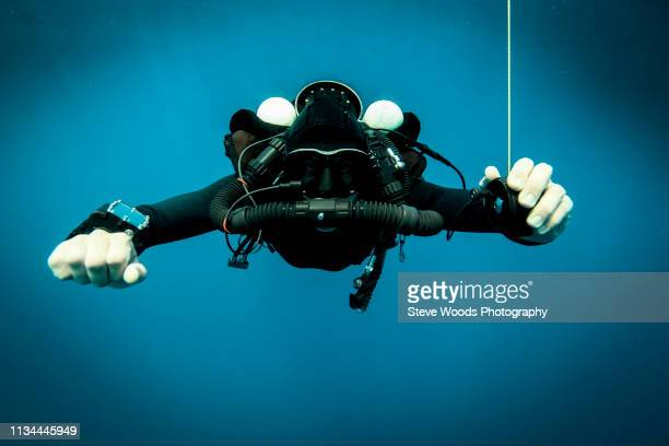 Technical diver performs a decompression stop whilst using a rebreather device, Lombok, Indonesia