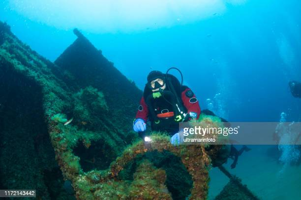 technical diving scuba diver used closed circuit rebreather  exploring and enjoying wreck diving over a shipwreck sea life  water sports techdive scuba diver point of view - aqualung diving equipment stock pictures, royalty-free photos & images
