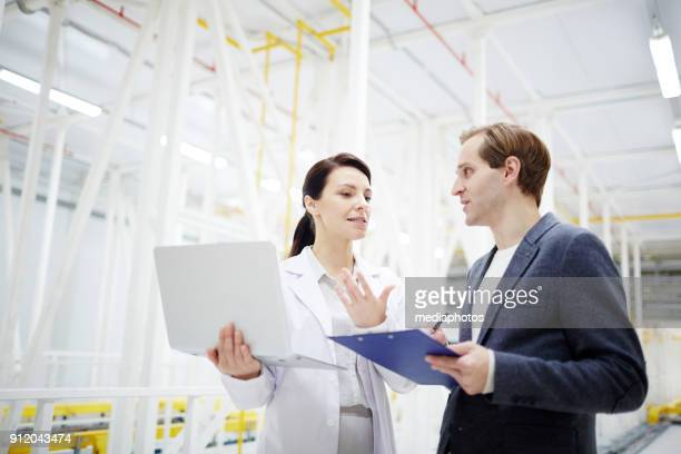 technical experts discussing mining process - financial technology stock photos and pictures