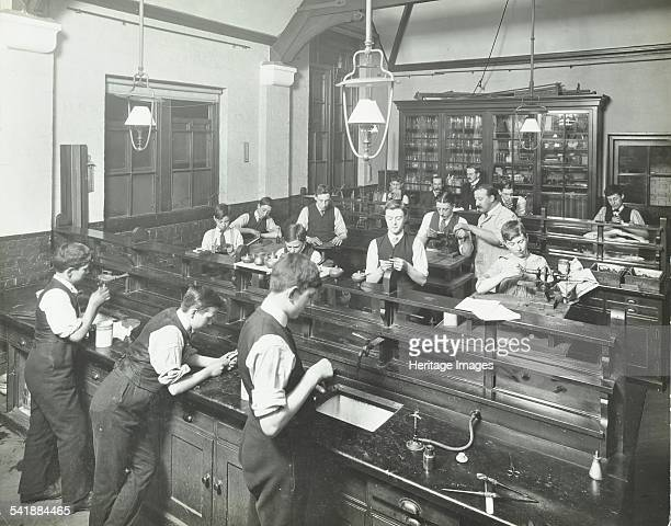 Technical instruction Haselrigge Road School Clapham London 1914 A class of boys being taught techniques for use in optical industries Artist unknown