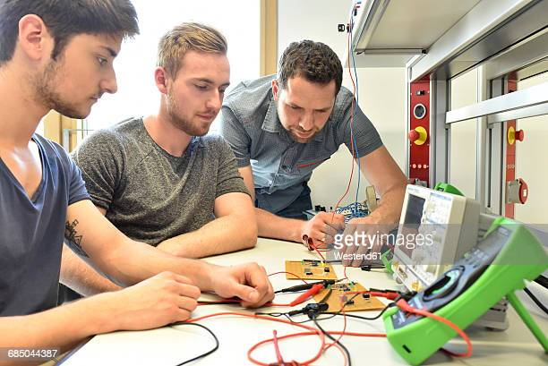 Technical instructor teaching students