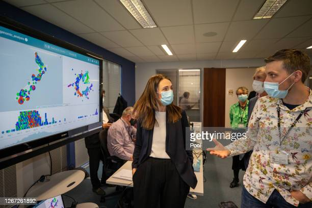 Technical Lead, Genomic Sequencing, Joep de Ligt talks to New Zealand Prime Minister Jacinda Ardern about the different COVID-19 genomes in New...
