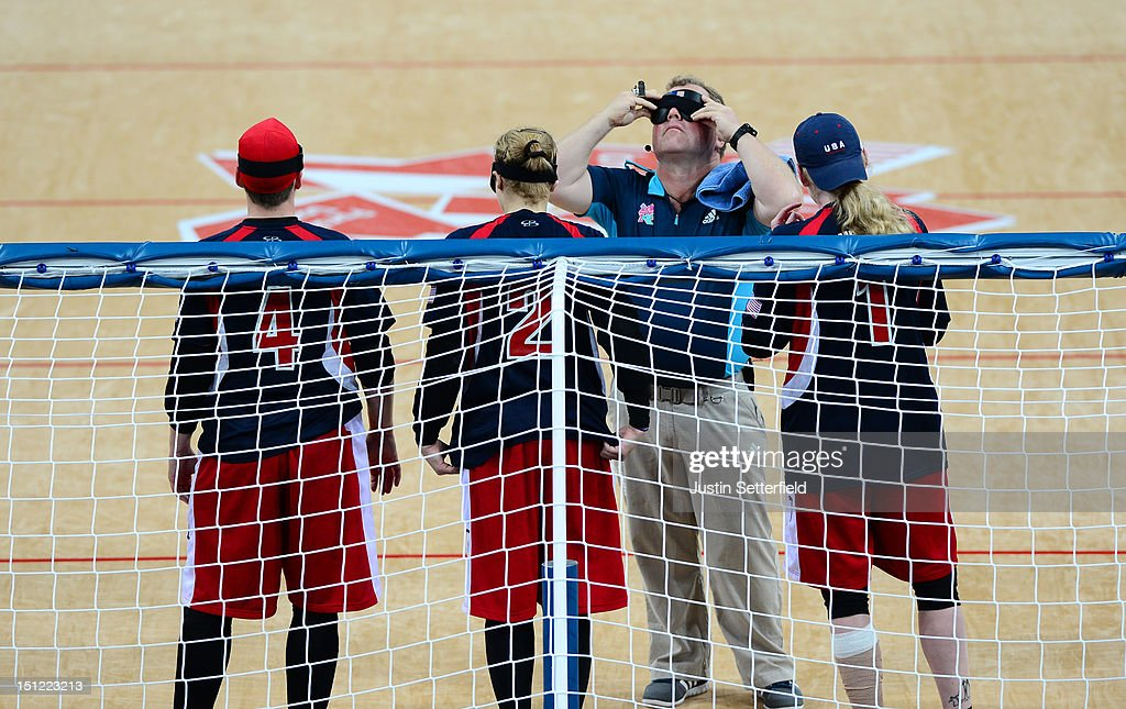 A technical offical tests the black-out goggles during the Women's Team Goalball preliminary round match between the United States and Canada on Day 6 of the London 2012 Paralympic Games at the Copper Box in the Olympic Park on September 4, 2012 in London, England. Canada went on to win the match 1-0.