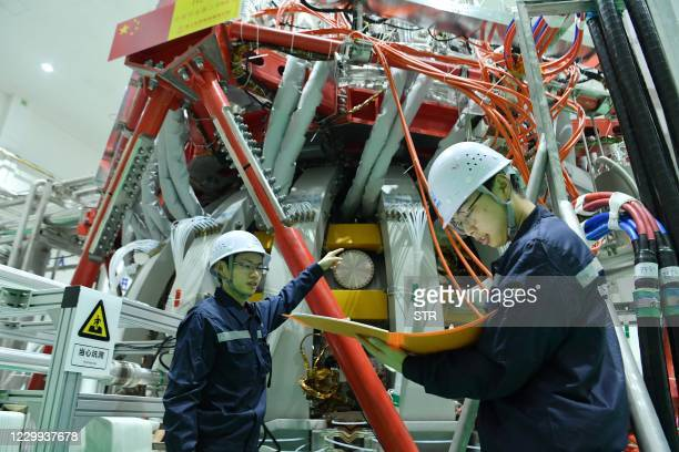 """Technical personnel checks the Chinas HL-2M nuclear fusion device, known as the new generation of """"artificial sun"""", at a research laboratory in..."""