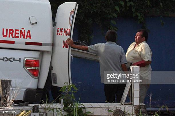 Technical police members unload a corpse from an ambulance at the morgue in San Cristobal on May 6 2015 Forensics officers found in the Venezuelan...