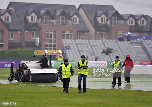 Technical team maintains the pitch as it rains before the start of the second Ireland v Sri Lanka oneday international cricket match at Clontarf...