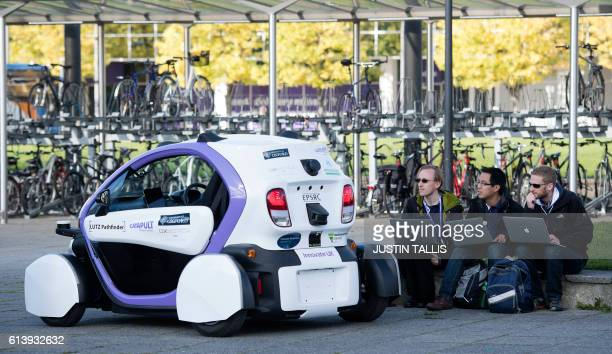 Technicans analise data follwong the trial of an autonomous selfdriving vehicle in a pedestrianised zone during a media event in Milton Keynes north...