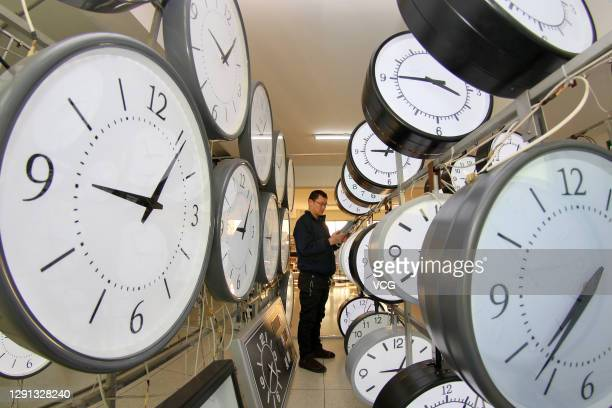 Technician adjusts equipment at a watch and clock company on December 15, 2020 in Yantai, Shandong Province of China.