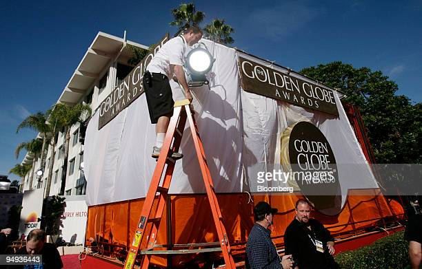 A technician adjusts lighting before the 66th Annual Golden Globes Awards in Beverly Hills California US on Sunday Jan 11 2009 Heath Ledger received...