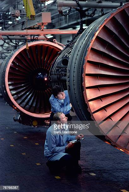 Technician and engineer at jet engine plant
