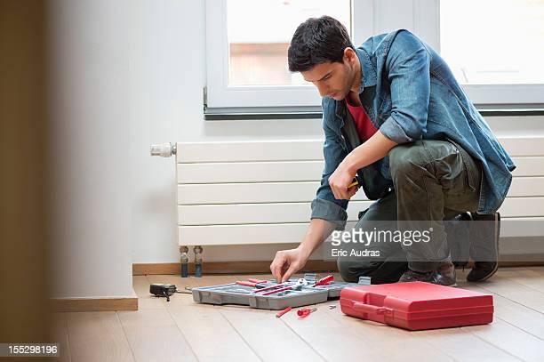 Technician arranging his toolbox