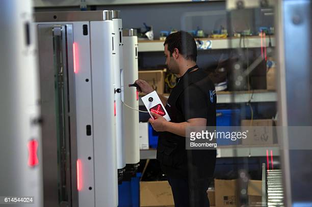 A technician assembles an Automated Border Control eGate which uses facial recognition technology for airport security at the VisionBox Solucoes De...