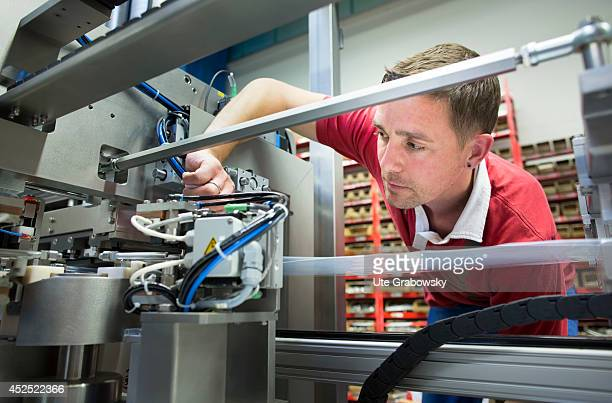 Technician assembling a machine for plastic packaging made from polyolefin at PLUEMAT mechanical engineering sales and marketing on July 08 in...