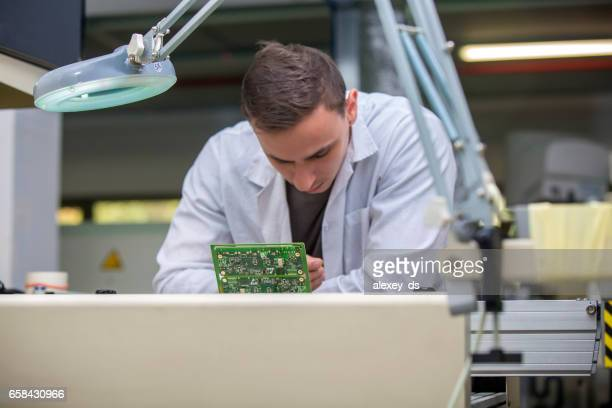 Technician Assembling circuit board