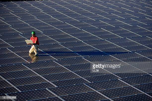 Technician at a photovoltaic farm