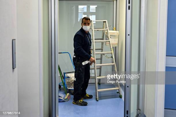Technician at work for the preparation of the area dedicated to Covid-19 inside the Mauriziano Hospital in Turin on October 12, 2020 in Turin, Italy....