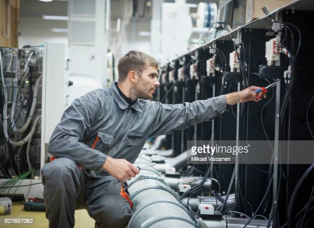 Technician at work in label printing company