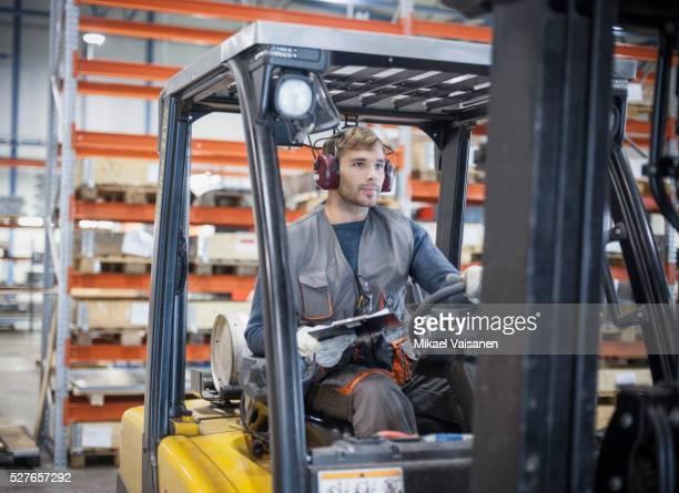 technician at work in sheet metal component factory - gabelstapler stock-fotos und bilder