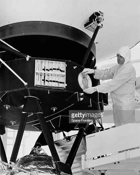 A technician attaches a gold record to a Voyager space probe USA circa 1977 Voyager 1 and its identical sister craft Voyager 2 were launched in 1977...