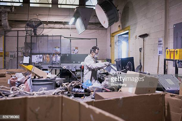 A technician breaks down electronics for recycling at the ADL Process Inc secondary facility in Toronto Ontario Canada on Monday May 2 2016 ADL...