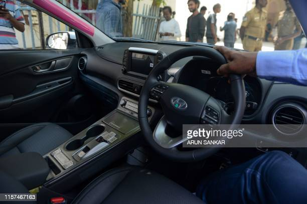 A technician briefs during the launch of Hyundai's India's first electric SUV 'KONA' at the Secretariat Park in Chennai on July 24 2019
