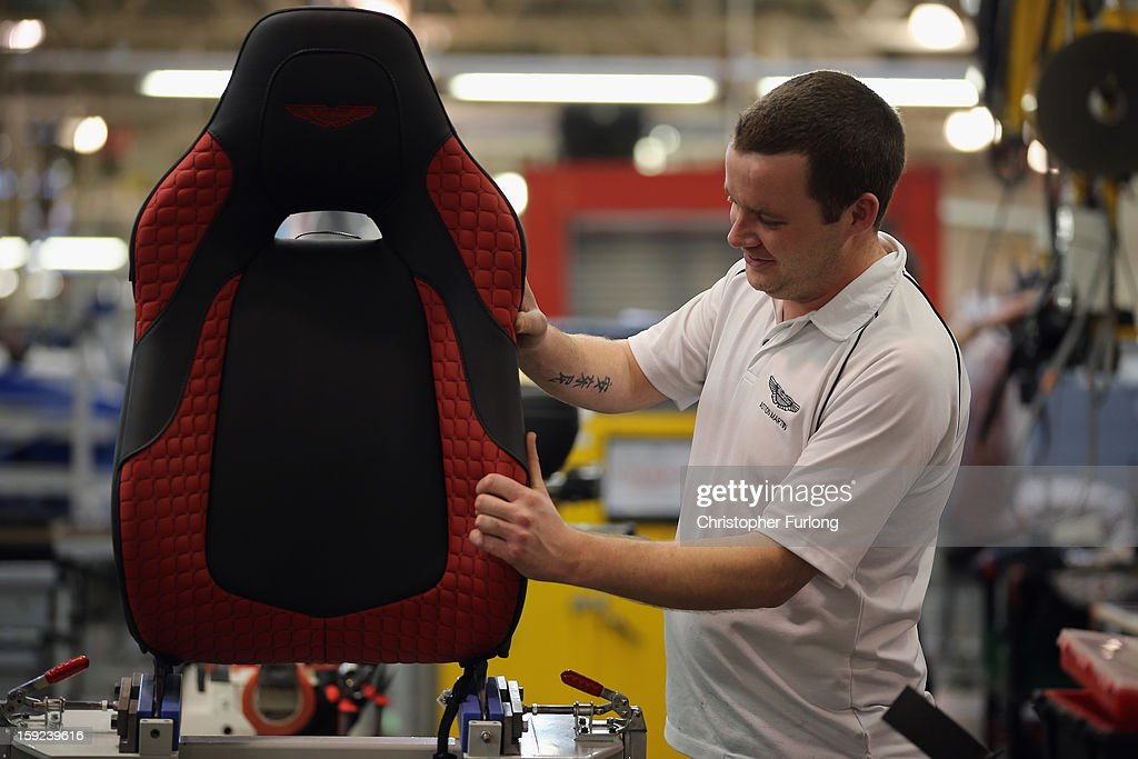 A technician builds the seat for an Aston Martin Vanquish at the company headquarters and production plant on January 10, 2013 in Gaydon, England. The iconic British brand is celebrating its 100th anniversary. Lionel Martin and Robert Bamford created Bamford & Martin on January 15 1913, which later became Aston Martin in honour of Bamford's wins at the Aston Clinton Hillclimb in Buckinghamshire.