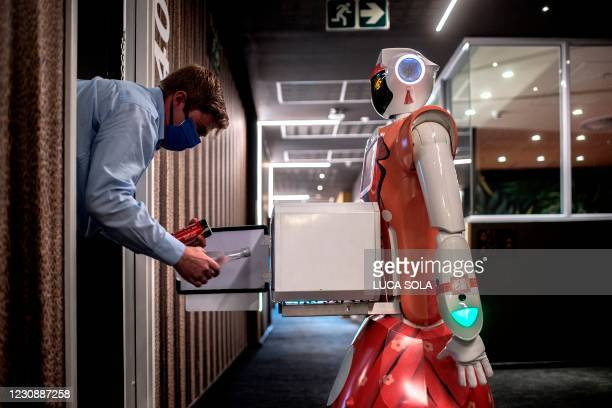 Technician by CTRL Robotics company performs a test of room service function of a robot in the Sky Hotel in Sandton, South Africa, on January 29,...