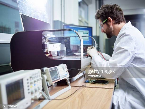 technician checking 3d printer - place of research stock pictures, royalty-free photos & images