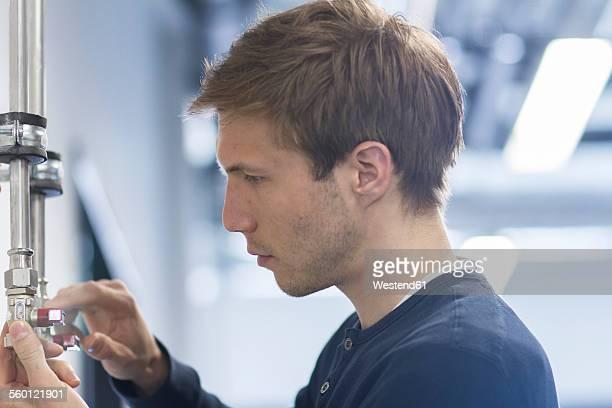 Technician checking installation