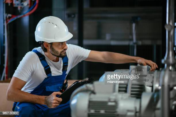 Technician checking the system