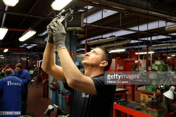 A technician checks a shotgun action receiver on April 4 2019 at the Perazzi Armi factory in Botticino Mattina a village in the outskirt of the city...